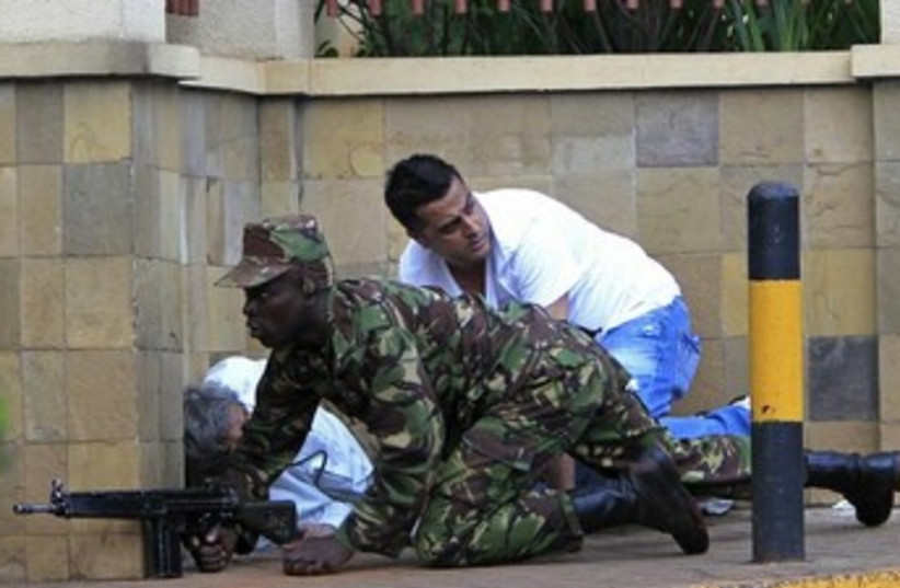 Kenyan soldier outside beseiged mall 370 (photo credit: REUTERS)