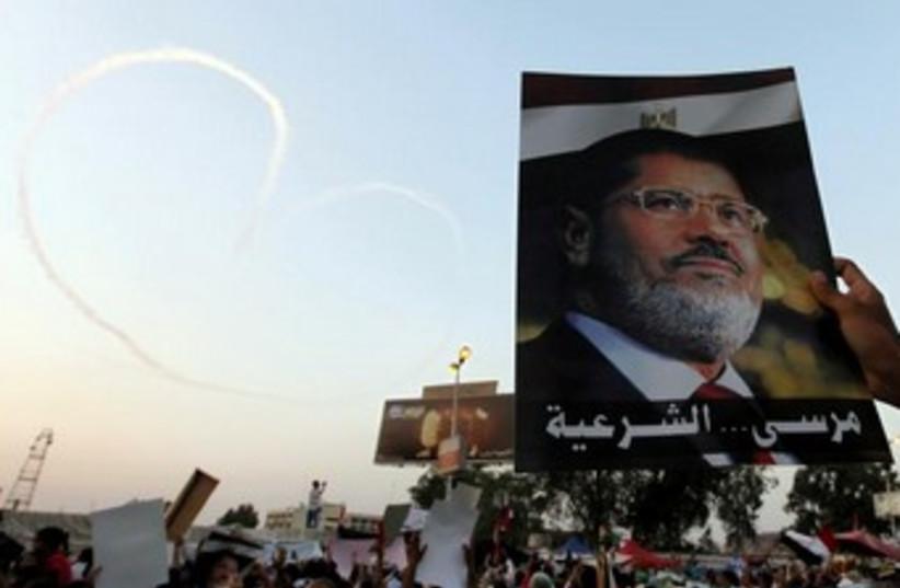 Morsi poster 370 (photo credit: REUTERS/Mohamed Abd El Ghany)