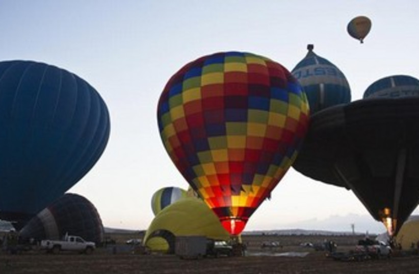 Hot air balloons are prepared during 2-day festival  (photo credit: REUTERS/Nir Elias)