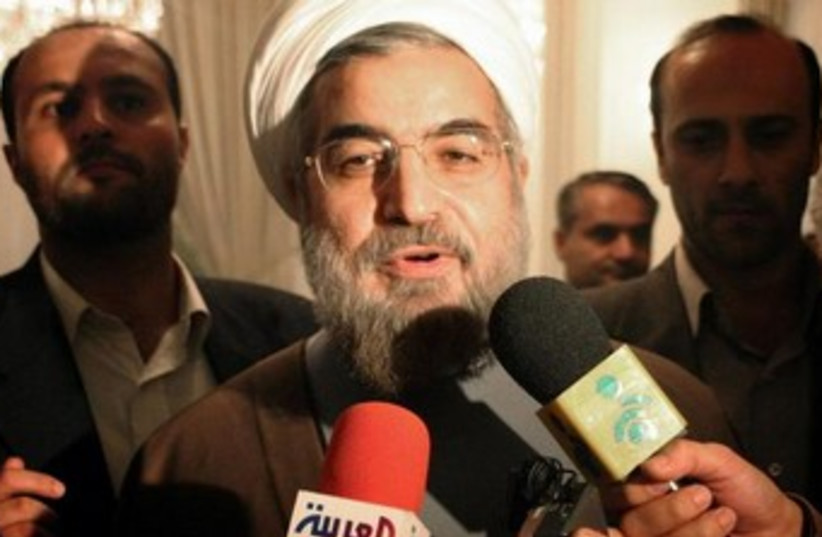 Rouhani talking to reporters 370 (photo credit: REUTERS)