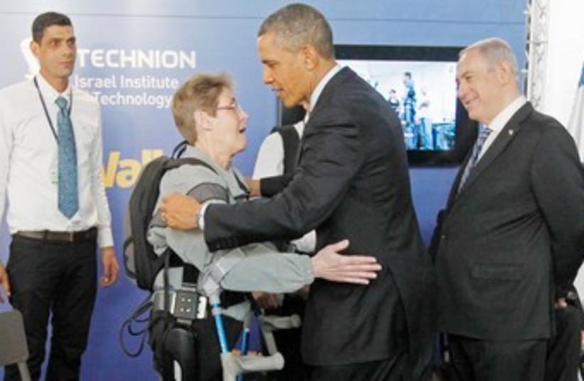 Obama with paralyzed US Army Sgt 370 (photo credit: Courtesy Argo Medical Technologies)