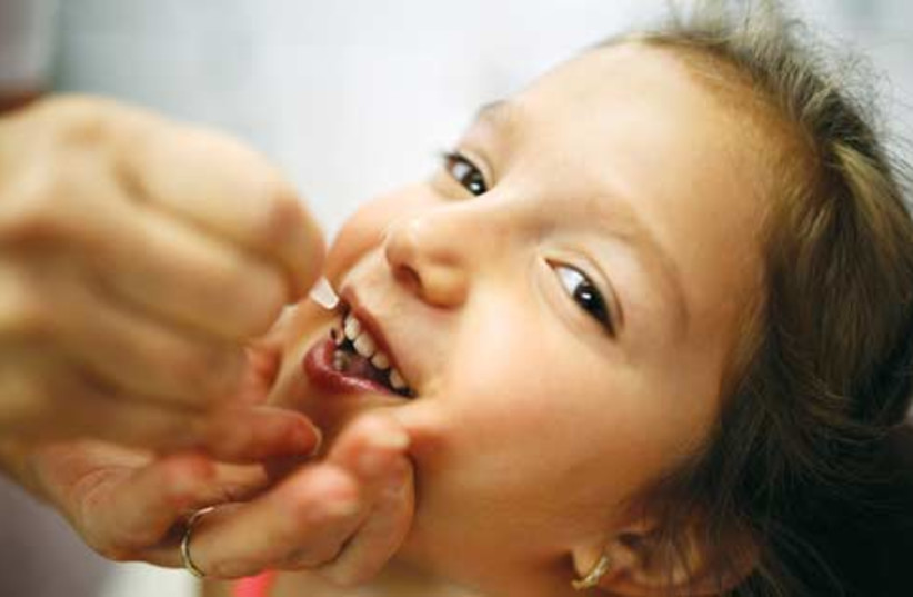 Vaccination against polio (photo credit: Reuters)