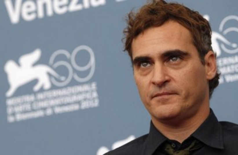 US actor Joaquin Phoenix poses during a photocall  (photo credit: Reuters)