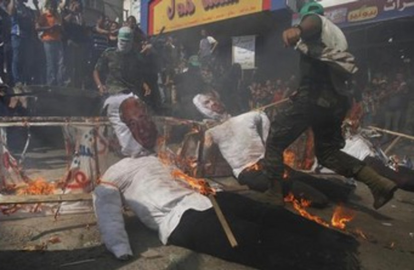 Burning Netanyahu, Peres dolls in Gaza 370 (photo credit: REUTERS/Ibraheem Abu Mustafa)