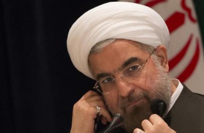 Rouhani on the phone 370 (photo credit: REUTERS)
