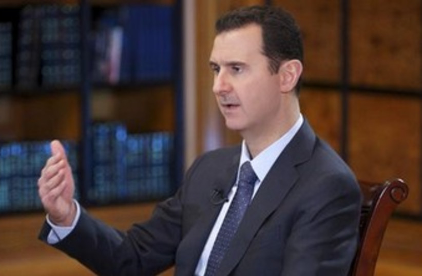 Bashar Assad interview 370 (photo credit: REUTERS/SANA/Handout)