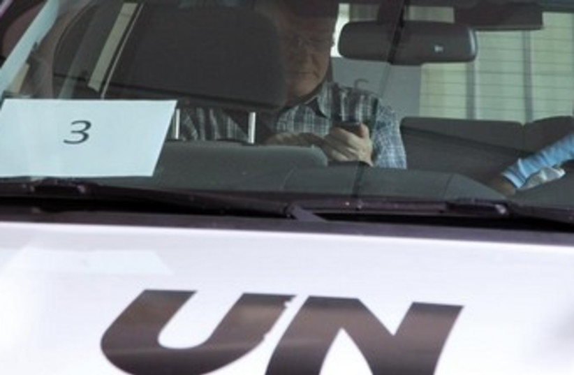 UN inspector in car 370 (photo credit: REUTERS)