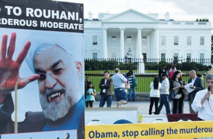 Vampire Rouhani protest sign 370 (photo credit: REUTERS)