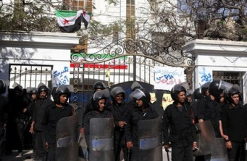 Police stand guard outside the Iranian ambassador's house 37 (photo credit: REUTERS)