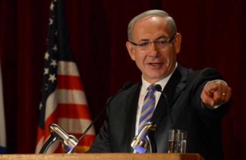PM Binyamin Netanyahu in glasses at podium 370  (photo credit: GPO / Kobi Gideon)