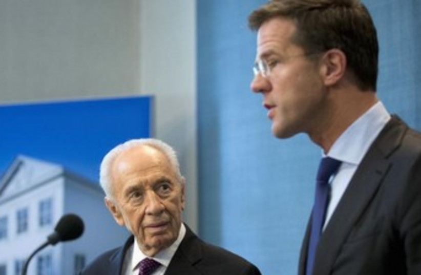 Shimon Peres and Dutch Prime Minister Mark Rutte 370 (photo credit: REUTERS/Bart Maat)