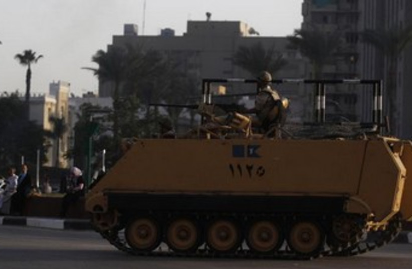 An Egyptian armored personnel carrier on alert in Cairo 370 (photo credit: Reuters)