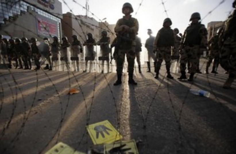 Egyptian soldiers stand guard near Rabaa al-Adawiya 370 (photo credit: REUTERS)