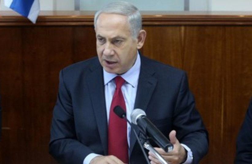 netanyahu at cabinet meeting gestures 150 (photo credit: Marc Israel Sellem/The Jerusalem Post)