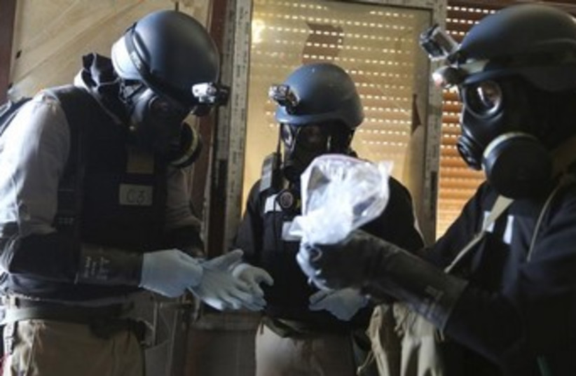 UN chemical inspectors in Syria 370 (photo credit: REUTERS/Mohamed Abdullah)