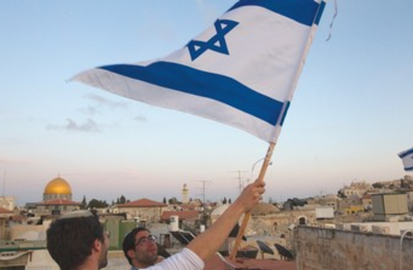 Israeli flag with Temple Mount background 370 (photo credit: REUTERS)