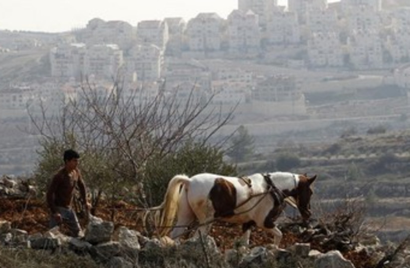 Palestinian farmer in the West Bank 370 (photo credit: REUTERS/Baz Ratner)