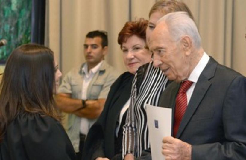 Shimon Peres with judge at ceremony 370 (photo credit: President's Spokesman)