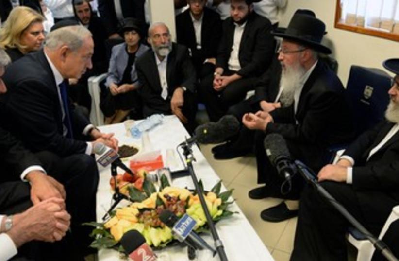netanyahu at yosef shiva 370 (photo credit: GPO)
