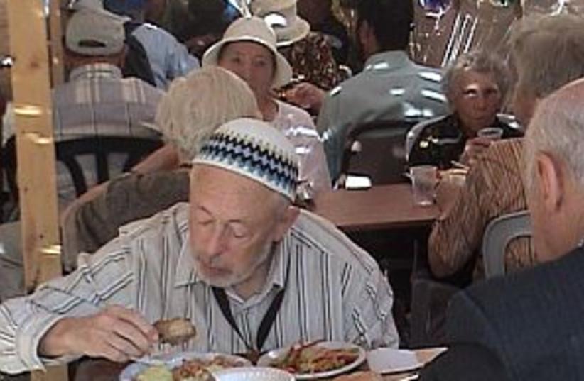 old man eating 298 (photo credit: Revital Aranbaev [file])