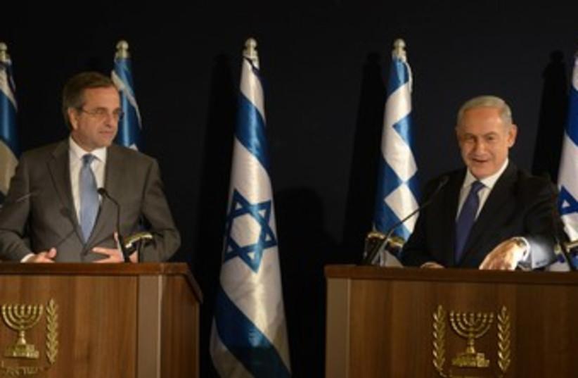 Netanyahu with Greek PM Antonis Samaras 370 (photo credit: Amos Ben-Gershom/GPO)