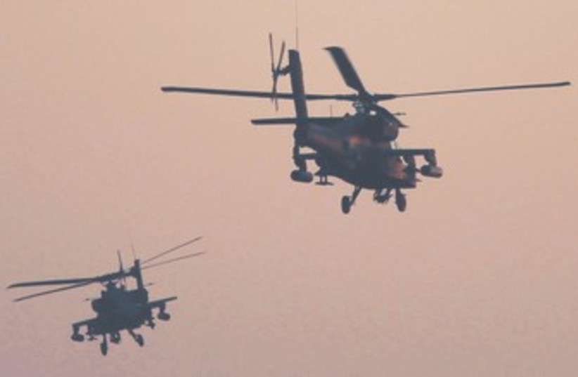 Egyptian Apache helicopters fly over Tahrir Square 370 (photo credit: REUTERS)