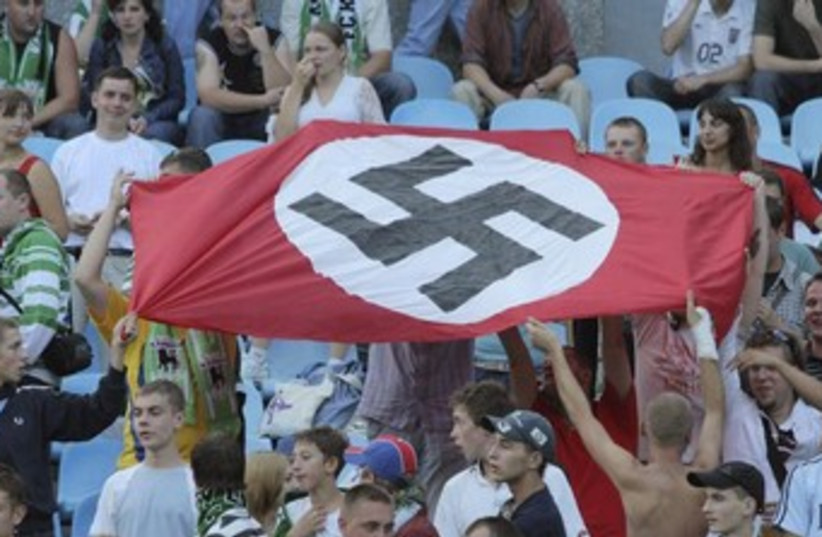 Soccer fans hold up Nazi swastika flag 370 (photo credit: REUTERS)