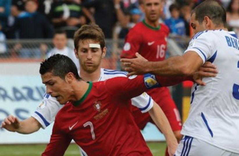 israel vs ronaldo 370 (photo credit: REUTERS)