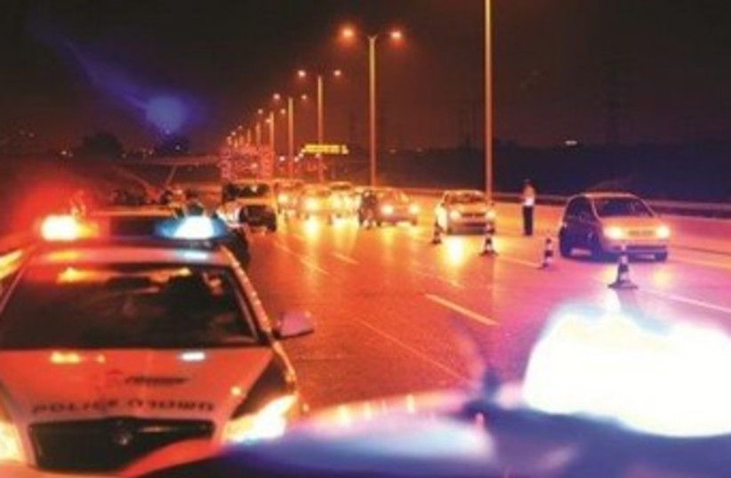 Police cars at night 370 (photo credit: Courtesy Israel Police)