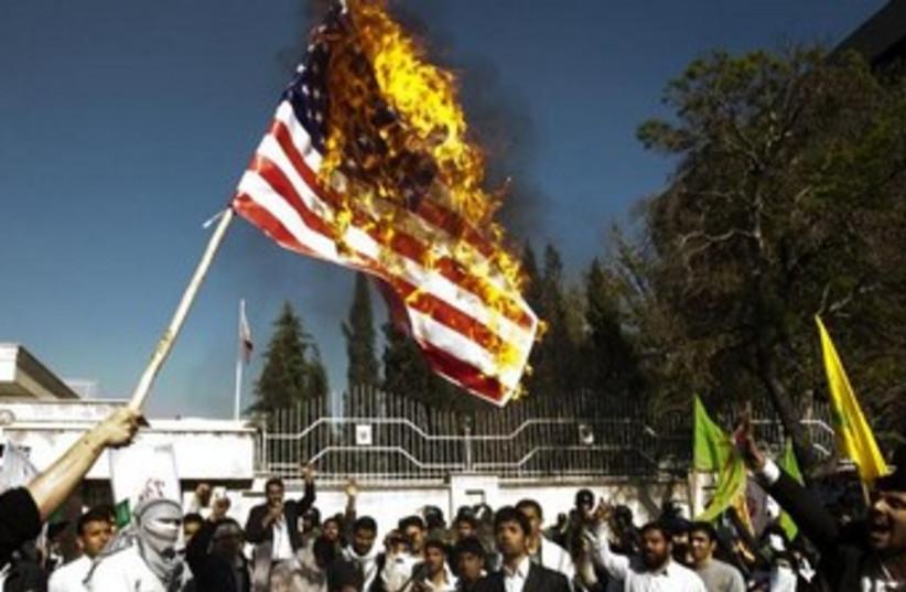 Iranian students burn US flag 370 (photo credit: REUTERS)