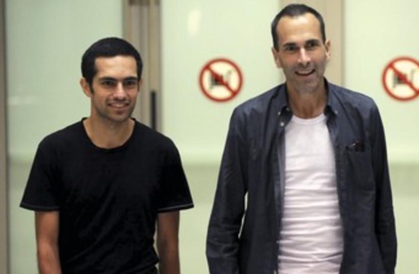 John Greyson (R) and Tarek Loubani arrive in Toronto (photo credit: Reuters)