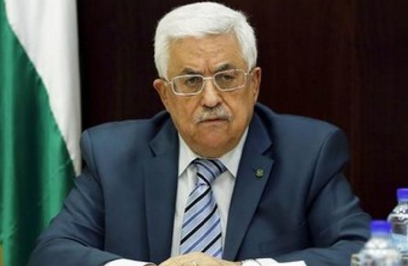 Abbas looking unhappy 370 (photo credit: REUTERS/Mohamad Torokman)