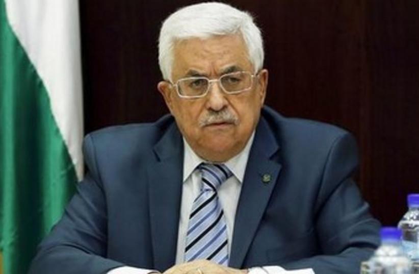 Abbas looking unhappy 370 (photo credit: REUTERS/Mohamad Torokman)