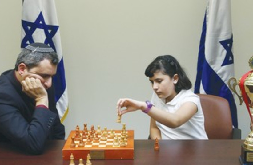 Elkin plays chess with little girl 370 (photo credit: Marc Israel Sellem/The Jerusalem Post)