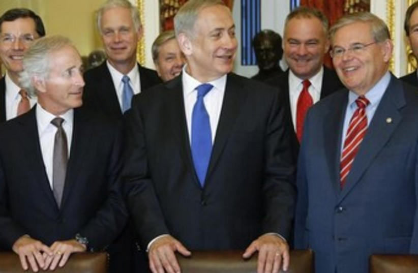 PM Netanyahu and Senators Robert Menendez and Bob Corker (photo credit: Reuters)