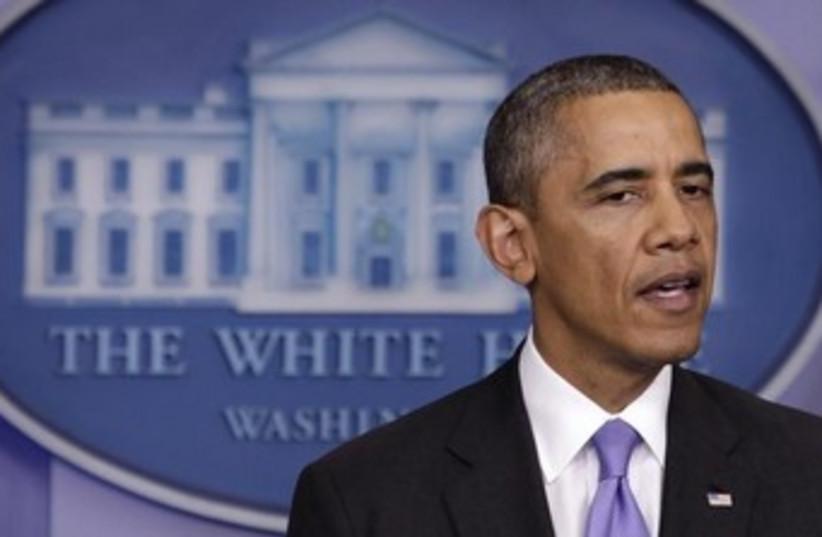 Obama talking about gov't shutdown 370 (photo credit: REUTERS/Yuri Gripas)