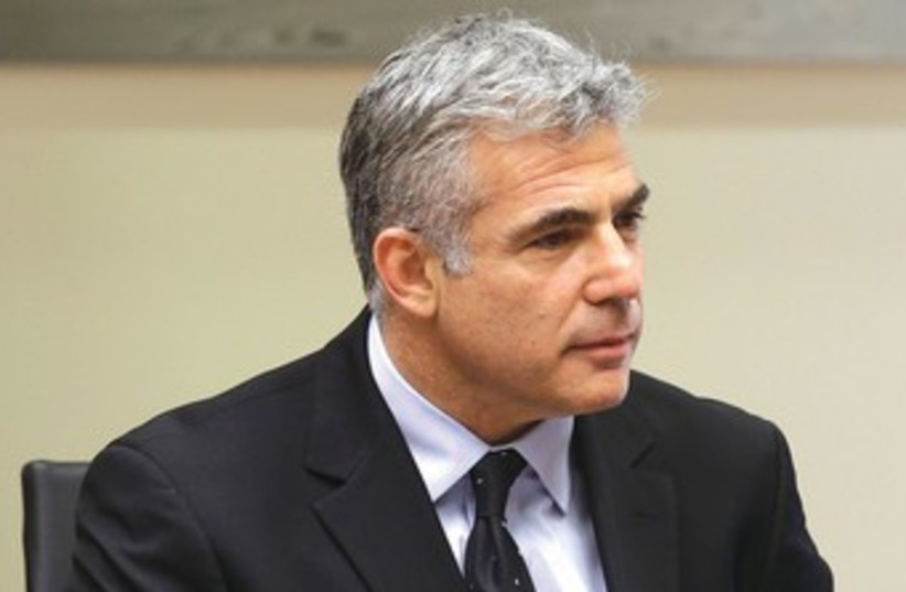 Lapid looking sharp 370 (photo credit: Marc Israel Sellem/The Jerusalem Post)