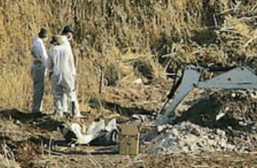 bodies exhume 224.88 (photo credit: AP)