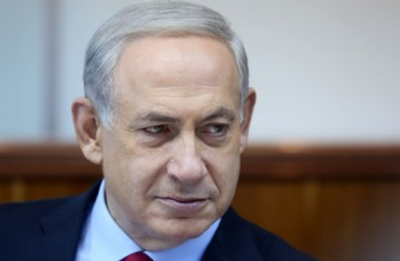 Netanyahu serious at cabinet meeting 370 (photo credit: Marc Israel Sellem/The Jerusalem Post)