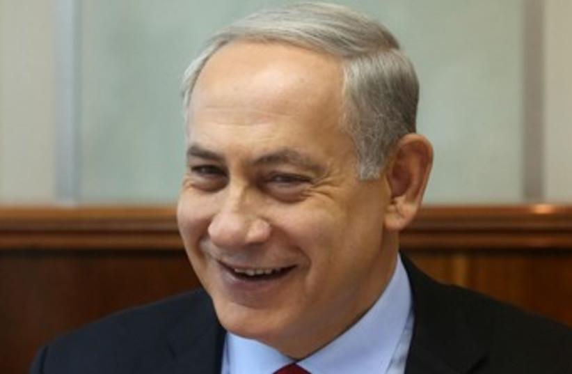 Netanyahu laughing 370 (photo credit: Marc Israel Sellem/The Jerusalem Post)