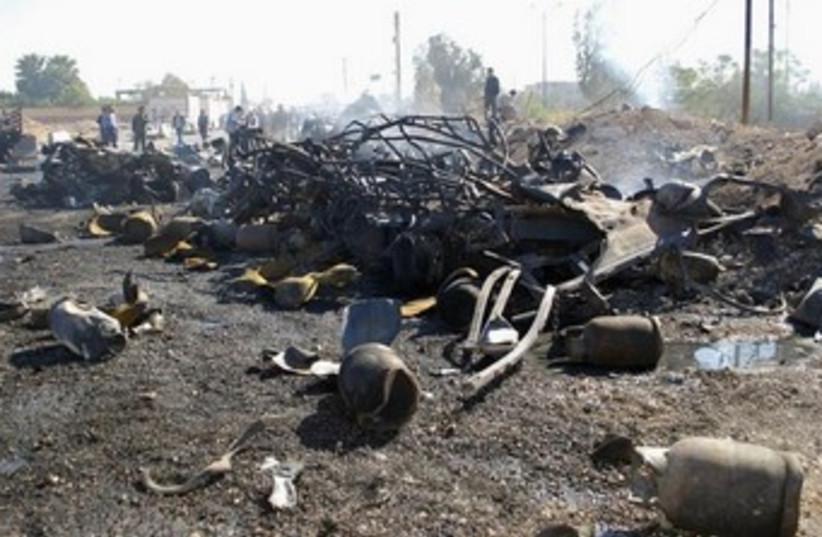 Debris from suicide bombing in Hama, Syria 370 (photo credit: REUTERS/SANA/Handout)
