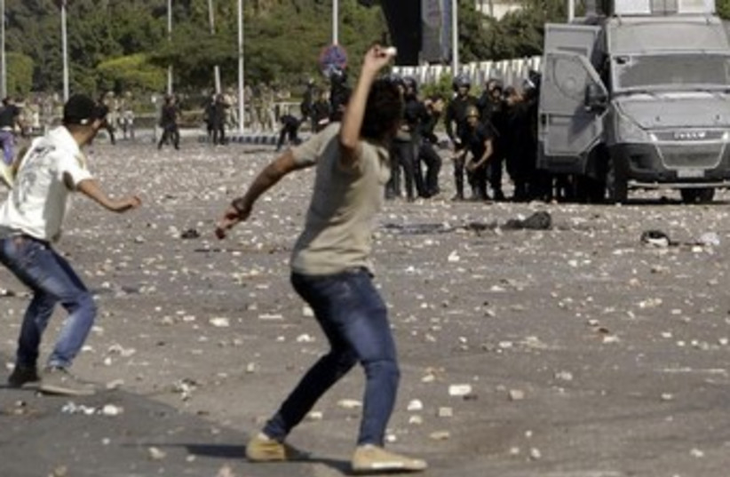 protesters clash with police in egypt 370 (photo credit: REUTERS)