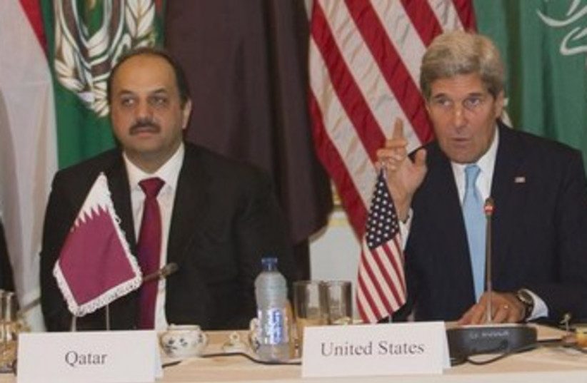Qatari Foreign Minister Khalid Bin al Attiyah (L) and Kerry (photo credit: Reuters)
