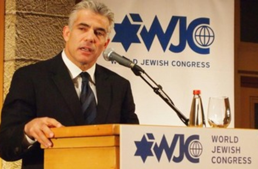 Yair Lapid addresses WJC conference 370 (photo credit: Sam Sokol)