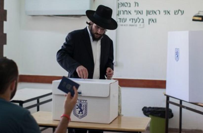 Haredi man voting 390 (photo credit: Marc Israel Sellem/The Jerusalem Post)