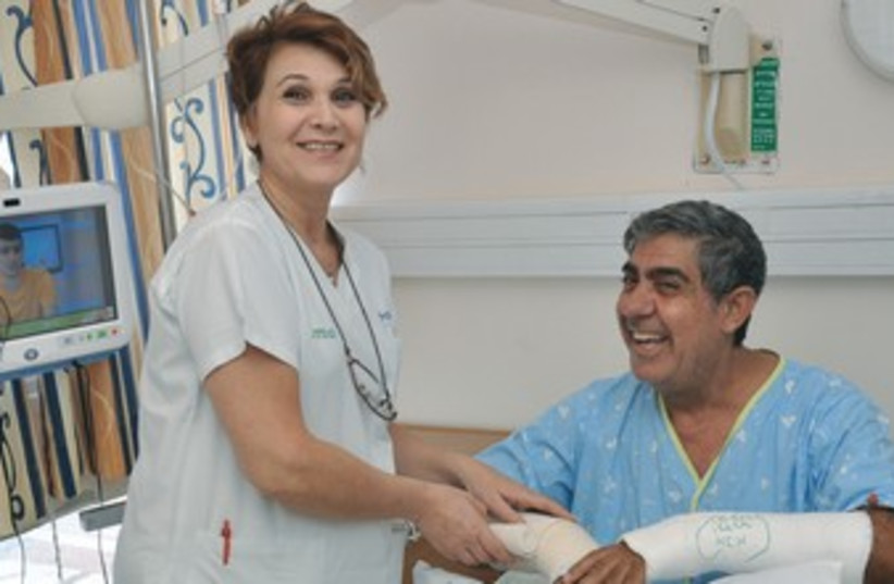 Man breaks arm voting 370 (photo credit: Courtesy Kaplan Medical Center)