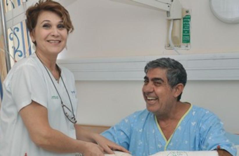 A nurse attends to Pini Levi at Kaplan Medical Center 370 (photo credit: Courtesy Kaplan Medical Center)
