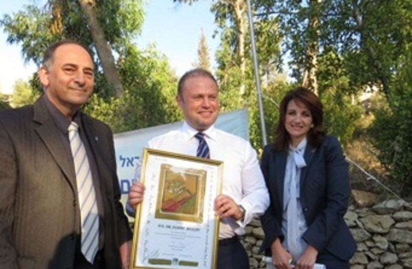 The Prime Minister of Malta Plants a Tree in Jlm Forest  (photo credit: KKL)