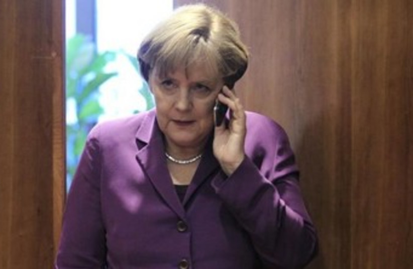 Angela Merkel on the phone 370 (photo credit: REUTERS/Yves Herman)
