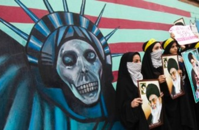 Anti-US poster on American embassy in Tehran 370 (photo credit: REUTERS)
